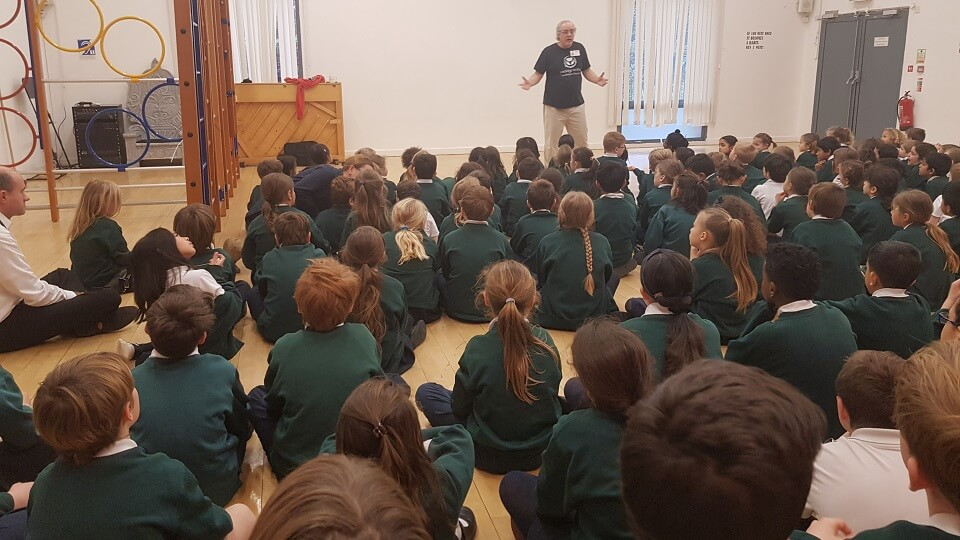 Ken Surridge chair of the charity Porridge and Rice talks to the school about life in the Nairobi slums