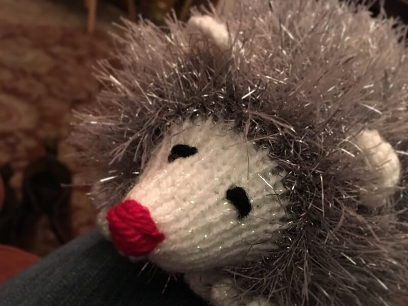knitted hedgehogs using wool containing tinsel are sold by Porridge and Rice to raise money for schools in Kenya