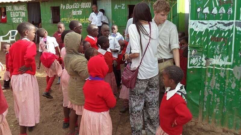 volunteers meet the pupils at Excel school in Ngando, an area within the Nairobi slums