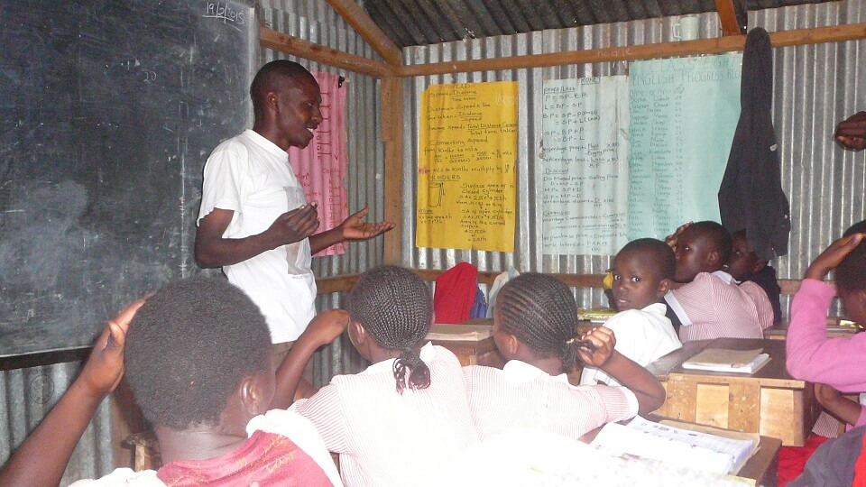 teacher Andrew conducts a maths lesson for his class