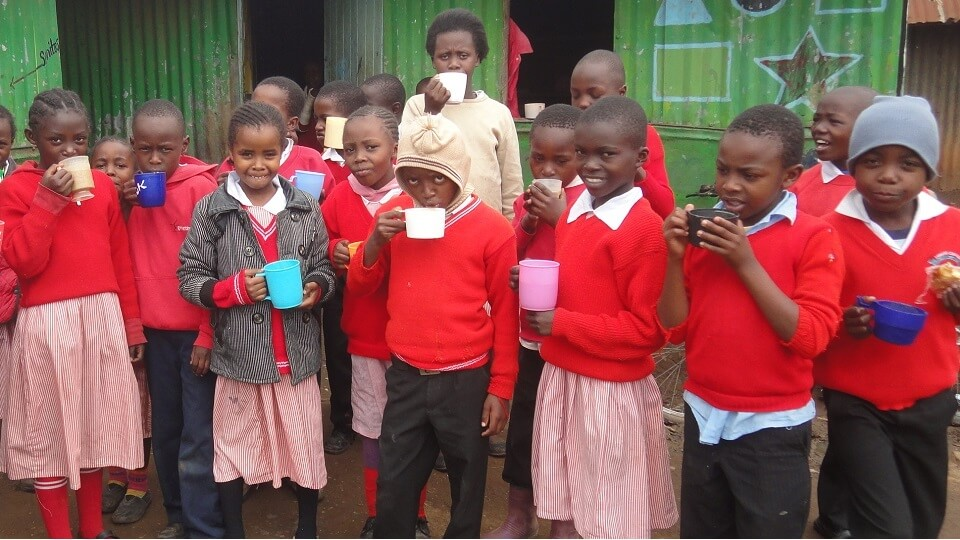 hot cups of Uji for breakfast at Excel school in the Nairobi slums