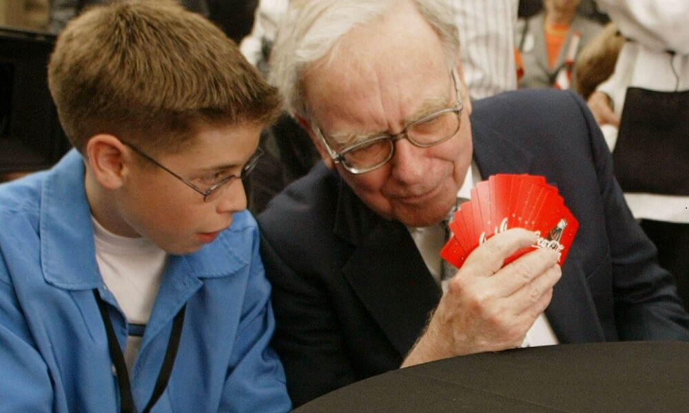 Warren Buffet shares his knowledge of the game Bridge with a younger player