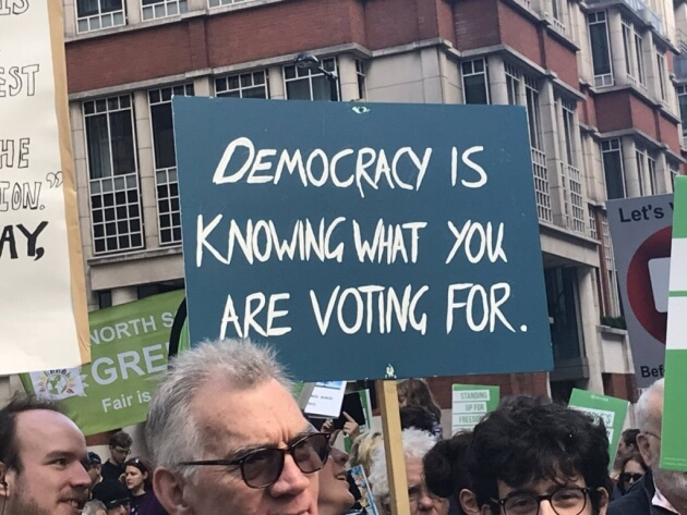 Democracy is knowing what you are voting for, a sign at the People's Vote March