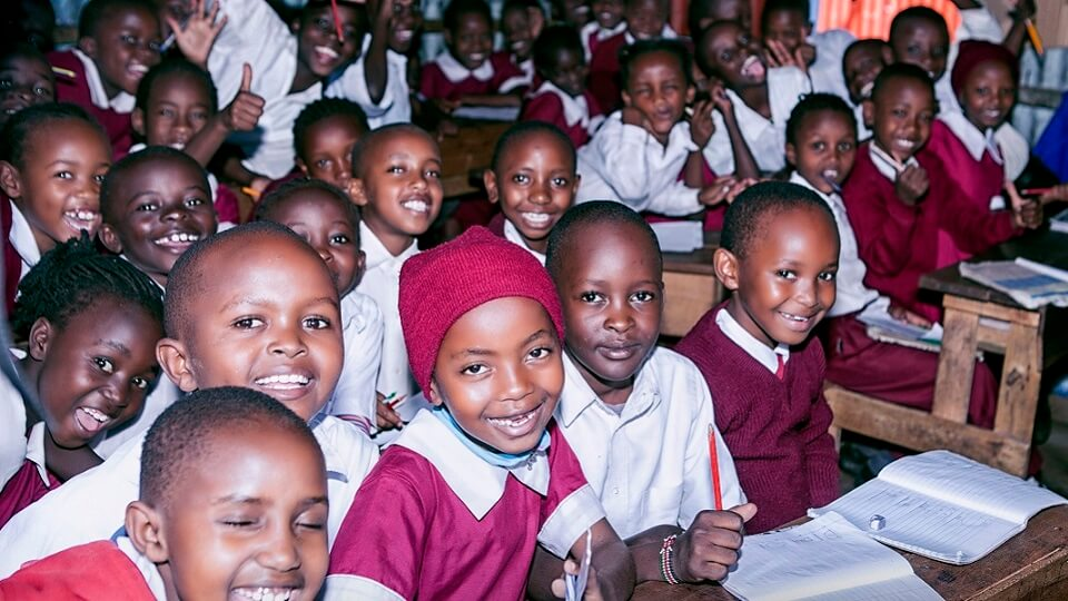 pupils at a Porridge and Rice partner school in the Nairobi slums home to people who are part of the extreme poor