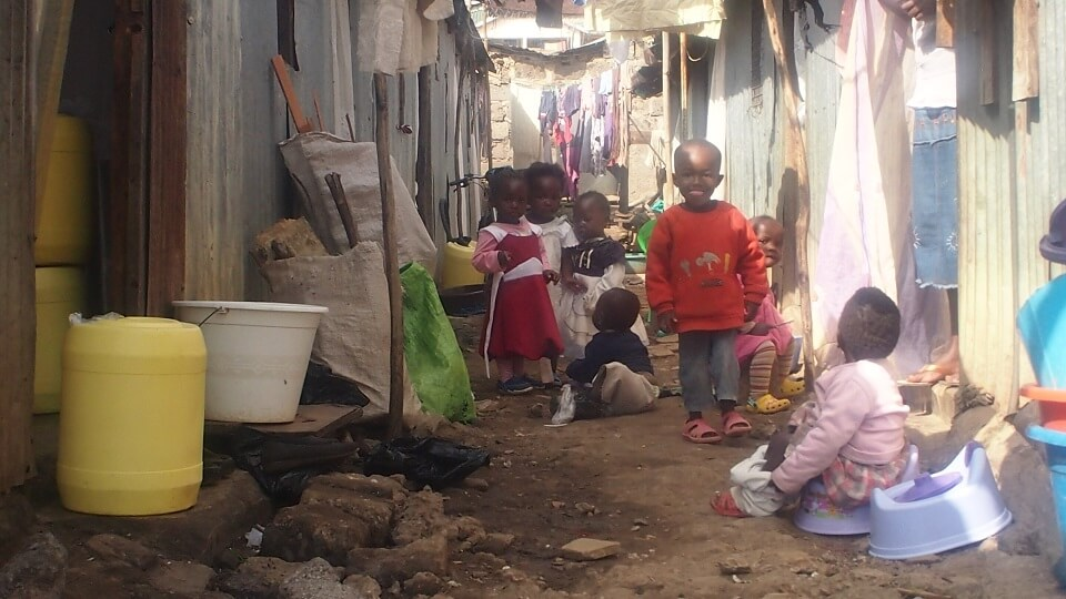a street in the Nairobi slums of shacks that have no toilets, electricity or running water yet habited by whole families in a single room