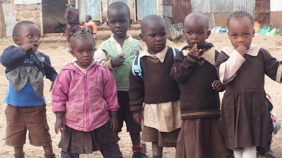 children in the Nairobi slums wear whatever clothes they can get their hands on as they cannot afford to buy new